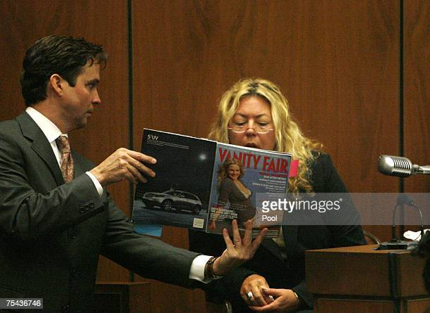 "Prosecutor Alan Jackson shows a copy of Vanity Fair magazine to witness ""Punkin Pie"" Irene Elizabeth Laughlin, a friend of victim Lana Clarkson,..."
