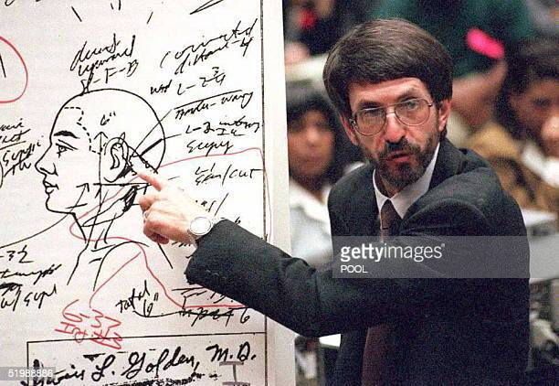 Prosecutor Brain Kelberg points to a chart showing where wounds were inflicted on murder victim Ronald Golman in the OJ Simpson murder trial 09 June...