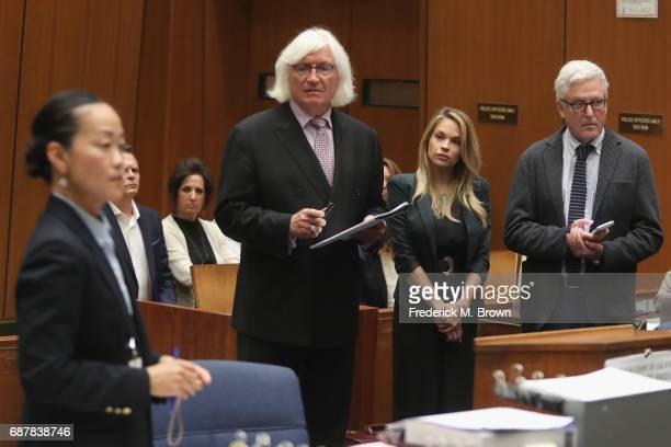 Prosecutor Chadd Kim speaks as attorney Thomas Mesereau model Dani Mathers and attorney Dana M Cole stand during court proceedings for a hearing at...