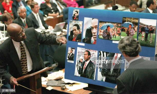 Prosecutor Christopher Darden and former Isotoner glove company executive Richard Rubin look at an exhibit of photographs 12 September in the OJ...