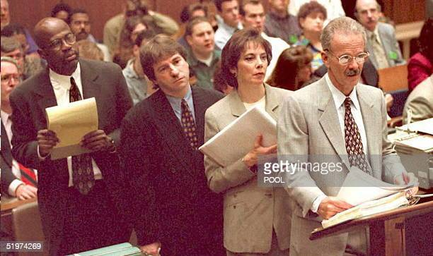 Prosecutor Christopher Darden defense lawyers Barry Scheck and prosecutors Marcia Clark and Rockne Harmon listen to Gary Sims a scientist with the...