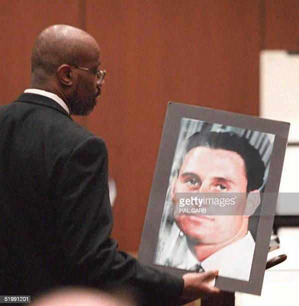 Prosecutor Christopher Darden holds up a photograph of murder victum Ronald Goldman while he addresses the jury during closing arguments 27 September...