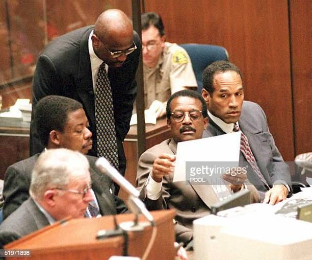 Prosecutor Christopher Darden shows a photograph of the residence where witness Rosa Lopez worked to defense attorney Johnnie Cochran Jr during the...