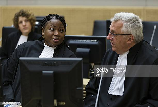 Prosecutor Fatou Bensouda speaks with deputy prosecutor James Stewart on March 27 2014 at the courtroom of the International Criminal Court in The...