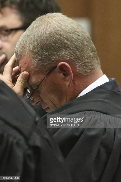 Prosecutor Gerrie Nel reacts as Judge Thokozile Masipa delivers judgement during the appeal by prosecutors against the verdict and sentence of South...