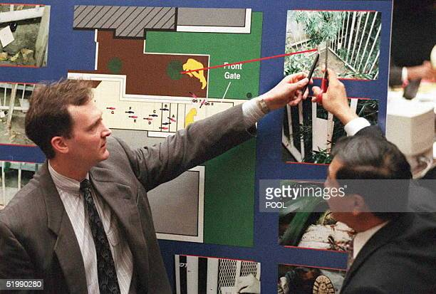 Prosecutor Hank Goldberg and forensic scientist Dr Henry Lee point to a picture of the Bundy crime scene 28 August during Goldberg's crossexamination...