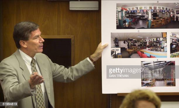 Prosecutor Jeff Dusek shows an evidence exhibit during the trial of David Westerfield 10 June 2002 at the San Diego courthouse Westerfield is accused...