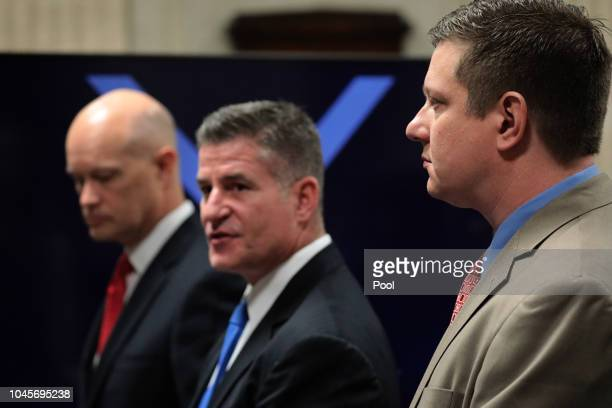 Prosecutor Joseph McMahon defense attorney Daniel Herbert and Jason Van Dyke approach the judge's bench at the start of Officer Jason Van Dyke trial...