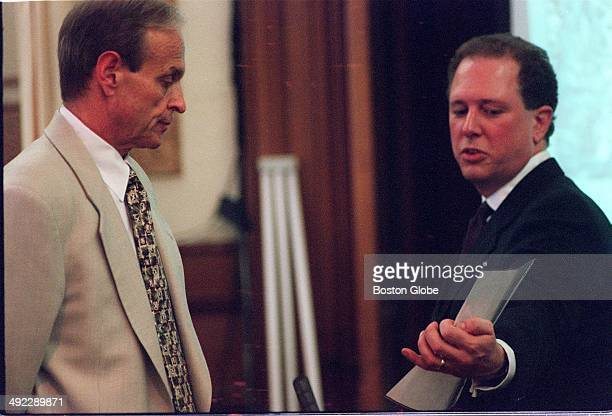 Prosecutor Rick Grundy right cross examines Dr Dirk Greineder left who is on trial for the murder of his wife at Norfolk Superior Court in Dedham...