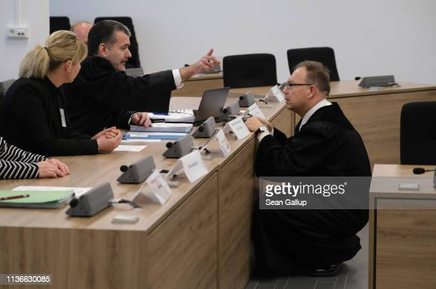 Prosecutor Stephan Butzkies consults with an accessory prosecutor on the first day of the trial of Alaa S for the possible murder of a German man in...