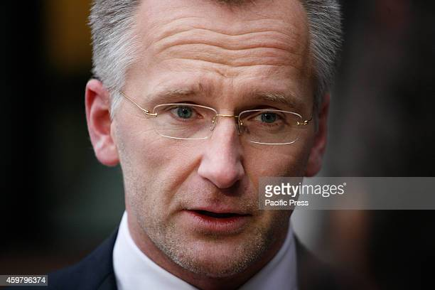 Prosecutor Wouter Bos talks to a journalists in front of the courthouse ahead of the verdict of three Jihad recruiters where people are seen arriving...