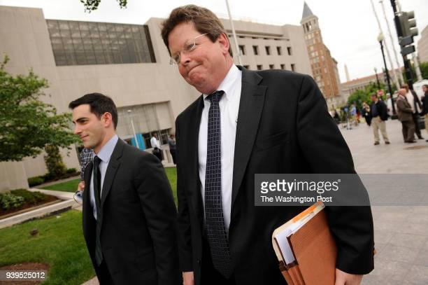 Prosecutors Adam Schwartz left and Bruce Hegyi leave the H Carl Moultrie Courthouse of the District of Columbia after five men were found guilty of...