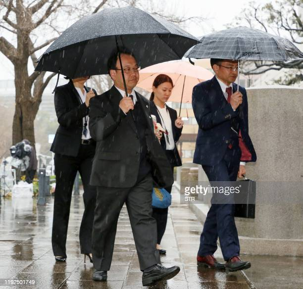 Prosecutors arrive at the Yokohama District Court ahead of a court hearing on the case of the man accused of the 2016 murder of 19 disabled people at...