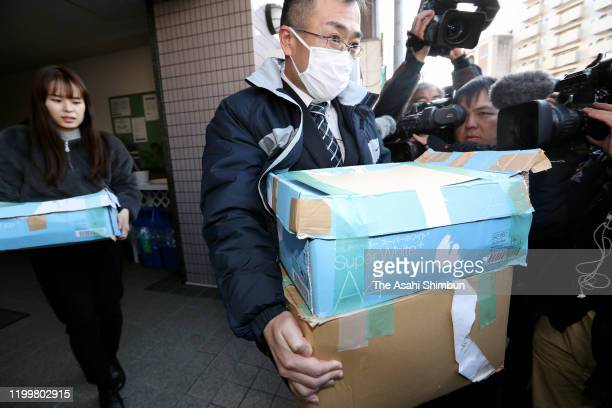 Prosecutors carry boxes after a raid of Upper House lawmaker Anri Kawai on January 15 2020 in Hiroshima Japan Anri Kawai was elected to the Upper...