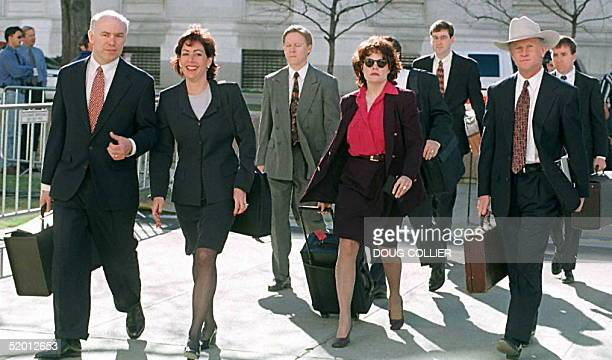 Prosecutors Larry Mackey and Beth Wilkinson of the US Department of Justice enter the Byron G Rogers Federal Building and United States Courthouse...