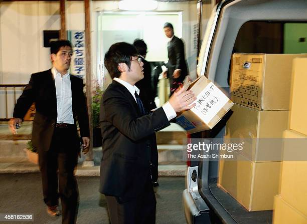 Prosecutors leave with cardboard boxes after the search at former trade minister Yuko Obuchi's Takasaki electoral support office on October 30, 2014...