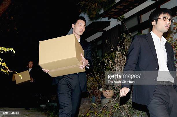 Prosecutors leave with cardboard boxes after the search of Kenichiro Orita, local aide of former trade minister Yuko Obuchi, on October 30, 2014 in...