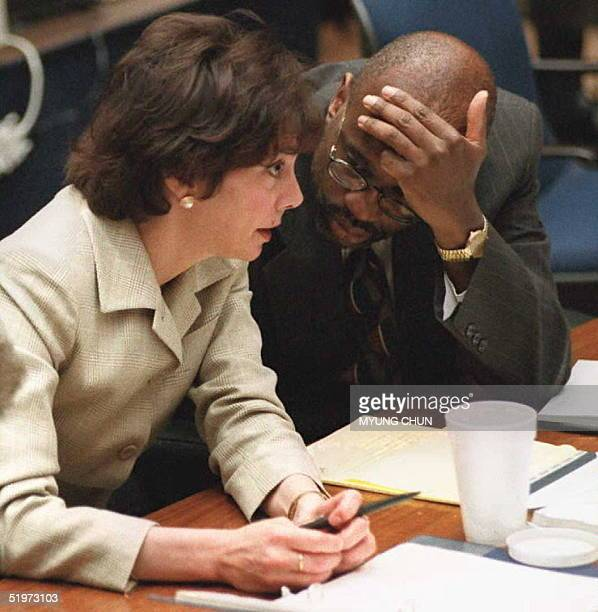 Prosecutors Marcia Clark and Christopher Darden confer during the crossexamination of Los Angeles police criminalist Andrea Mazzola 25 April in the...