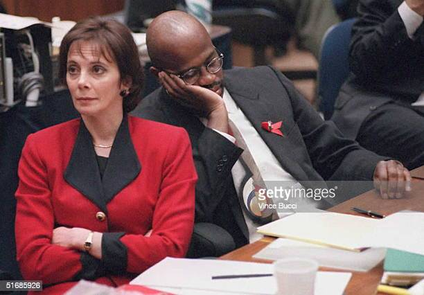 Prosecutors Marcia Clark and Christopher Darden listen to defense lawyer Johnnie Cochran Jr 27 September while he addresses the jury during closing...