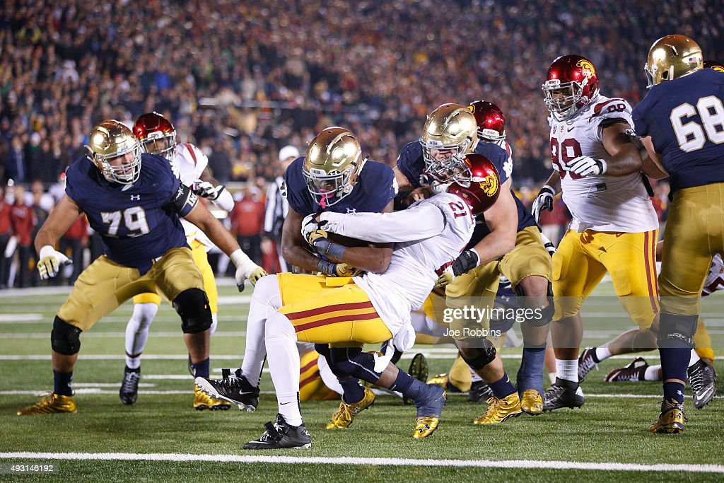 C.J. Prosise #20 of the Notre Dame Fighting Irish plows into the end zone with a six-yard touchdown run against the USC Trojans in the fourth quarter of the game at Notre Dame Stadium on October 17, 2015 in South Bend, Indiana.