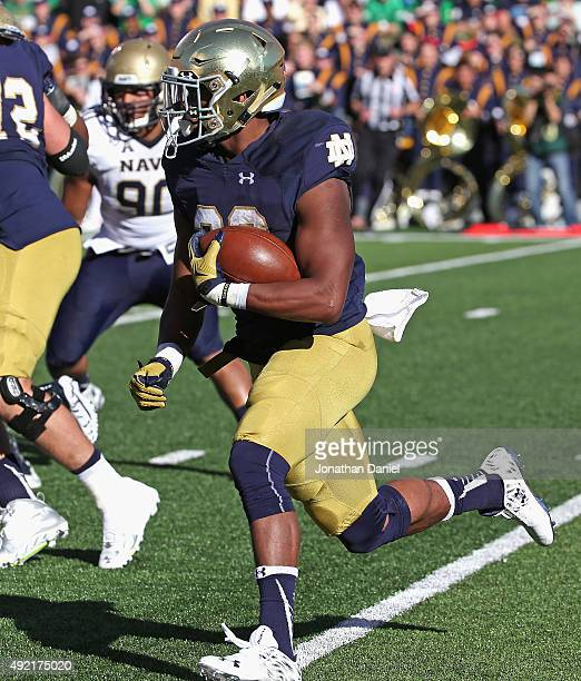 J Prosise of the Notre Dame Fighting Irish runs for a touchdown against the Navy Midshipmen at Notre Dame Stadium on October 10 2015 in South Bend...