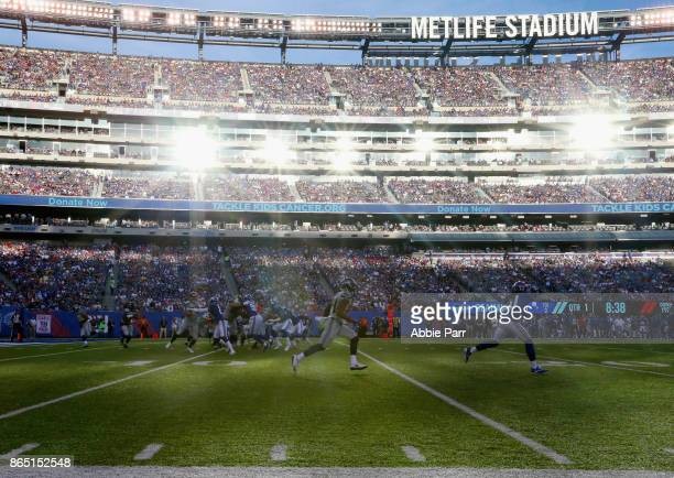 J Prosise of the Seattle Seahawks runs the ball against the New York Giants during the first quarter of the game at MetLife Stadium on October 22...