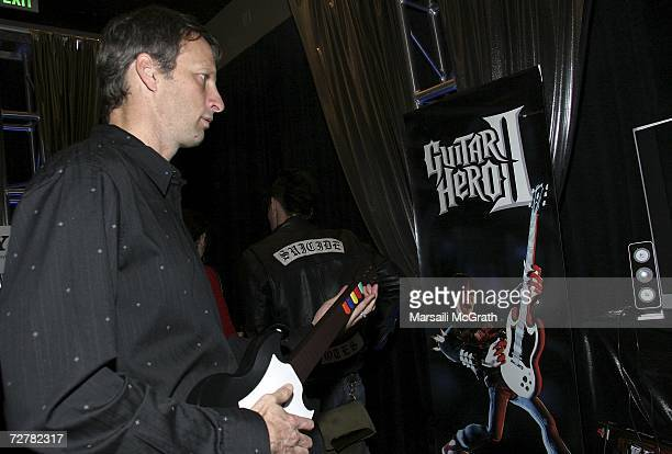 ProSkater Tony Hawk poses with the Guitar Hero display at the distinctive assets gift lounge during Spike TV's Video Game Awards held at The Galen...