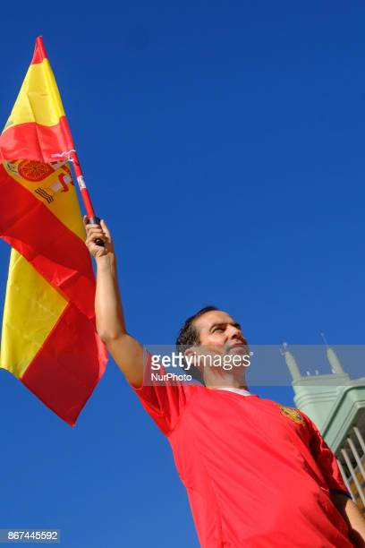 ProSpain demonstrators wave Spanish national flags in Colon Square during a protest for Spanish unity in Madrid Spain on Saturday Oct 28 2017 The...