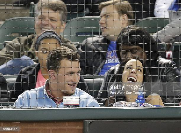 NFL prospect Johnny Manziel watches the game with friends as the Texas Rangers play host to the Seattle Mariners at Globe Life Park in Arlington...