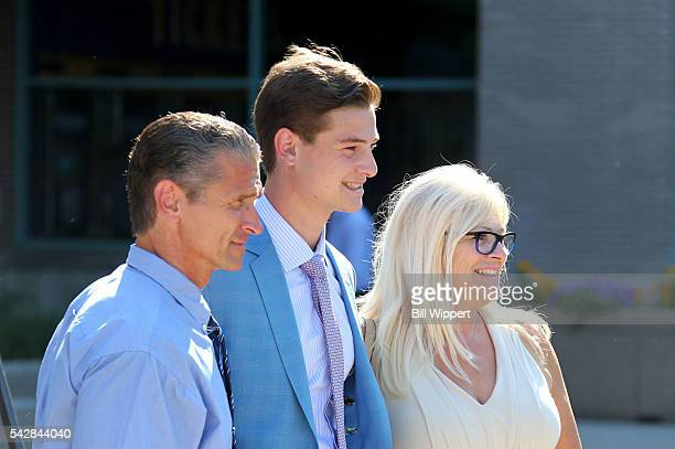 NHL prospect Julien Gauther poses for a photo with his parents outside First Niagara Center prior to round one of the 2016 NHL Draft at First Niagara...