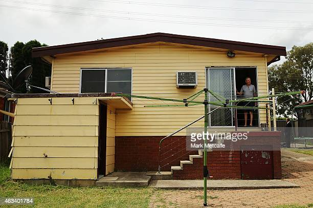 A prospective buyer views the property before the home auction for a fourbedroom house at 230 Blacktown Road on February 14 2015 in Blacktown...