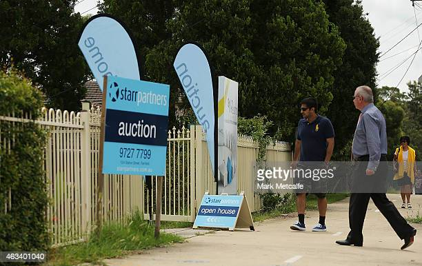 Prospective buyers arrive for the auction for a fourbedroom house at 230 Blacktown Road on February 14 2015 in Blacktown Australia The Blacktown home...