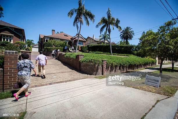 Prospective buyers enter a house for sale during an open inspection in the suburb of Eastwood in Sydney Australia on Saturday Jan 11 2014 Purchases...