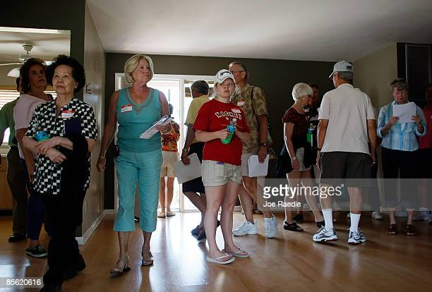 Prospective buyers inspect a foreclosed home that they are seeing as they take a foreclosure boat tour with Foreclosures 'R Us realty company on...