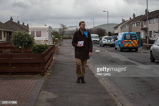 Prospective Conservative MSP for Dumfriesshire Oliver Mundell canvasses on the streets of a housing estate on May 4 2016 in Dumfries Scotland The son...