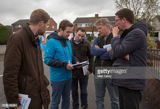 Prospective Conservative MSP for Dumfriesshire Oliver Mundell talks with his campaign team as he canvasses on the street of a housing estate on May 4...