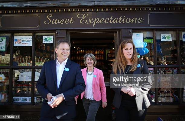 Prospective Conservative party candidates Anna Firth and Kelly Tolhurst emerge from a sweet shop with party Chairman Grant Shapps as they campaign...