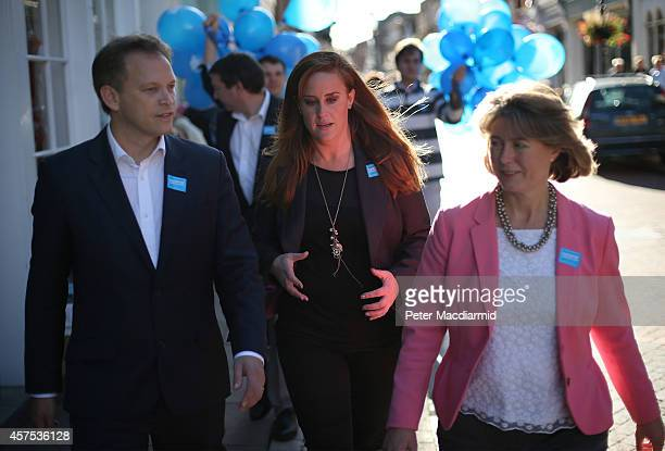 Prospective Conservative party candidates Anna Firth and Kelly Tolhurst walk with party Chairman Grant Shapps as they campaign together on October 20...
