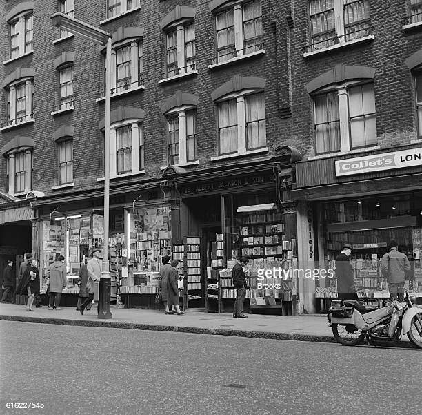 Prospective customers browsing outside bookshops on London's Charing Cross Road known for its specialist and secondhand bookshops 31st January 1967...