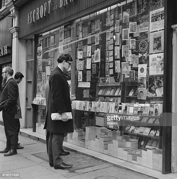 Prospective customers browsing outside the Ashcroft and Daw book and record shop on Charing Cross Road London 31st January 1967 The street is known...