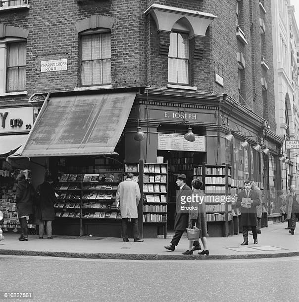 Prospective customers browsing outside the E Joseph bookshop on the corner of Charing Cross Road and Great Newport Street London 31st January 1967...