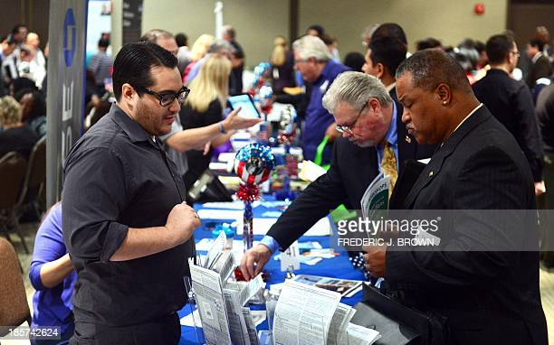 Prospective job seekers meet with company reps at the annual Honor a Hero Hire a Vet job resource fair in Van Nuys California on October 24 2013 The...