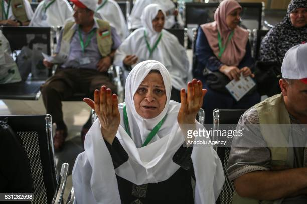 A prospective pilgrim woman prays as she waits to cross Rafah border crossing before moving forward to the Muslims' Holiest city of Mecca of Saudi...