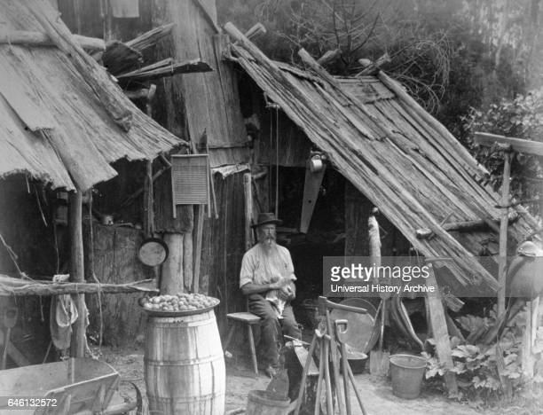 Prospector sits in front of his prospectors hut in the gold rush in Australia In September 1892 gold was found at Fly Flat
