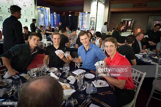 NHL prospects Nikolay Goldobin Ivan Barbashev Samuel Morin and Travis Sanheim open packs of Upper Deck hockey cards during dinner at the Hockey Hall...