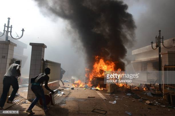 Prostestors enter the parliament in Ouagadougou on October 30 2014 Hundreds of angry demonstrators in Burkina Faso stormed parliament on October 30...