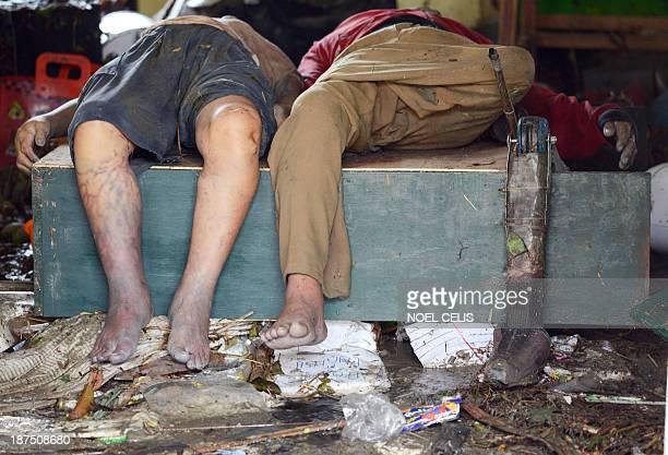 Prosthetic leg is seen beside a dead body inside the Fisherman's Village Elementary School of Tacloban, eastern island of Leyte on November 10, 2013....