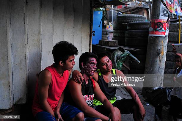 Prosthetics and special effects artists share a light moment after testing for themed events on October 28 2013 in Manila Philippines The Oceanima...