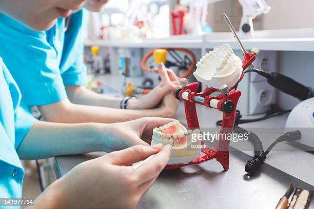 prosthodontic lab, focus on dentures - implant stock photos and pictures