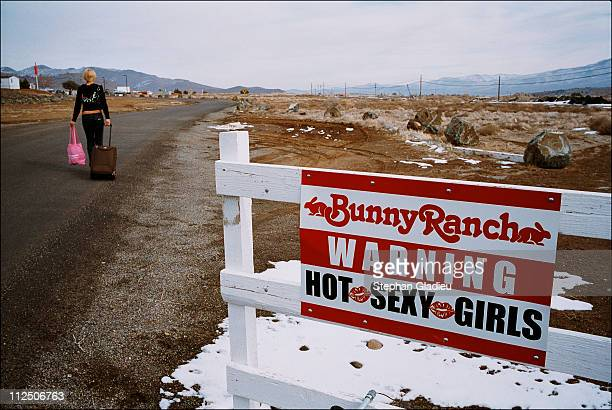Prostitue arrives for work, passing the sign at the entrance of the Moonlite Bunny Ranch, a legal brothel owned by Dennis Hof, in Lyon County, one of...